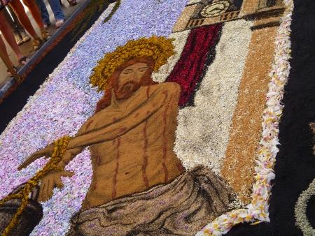 Jesus auf Blumenteppich